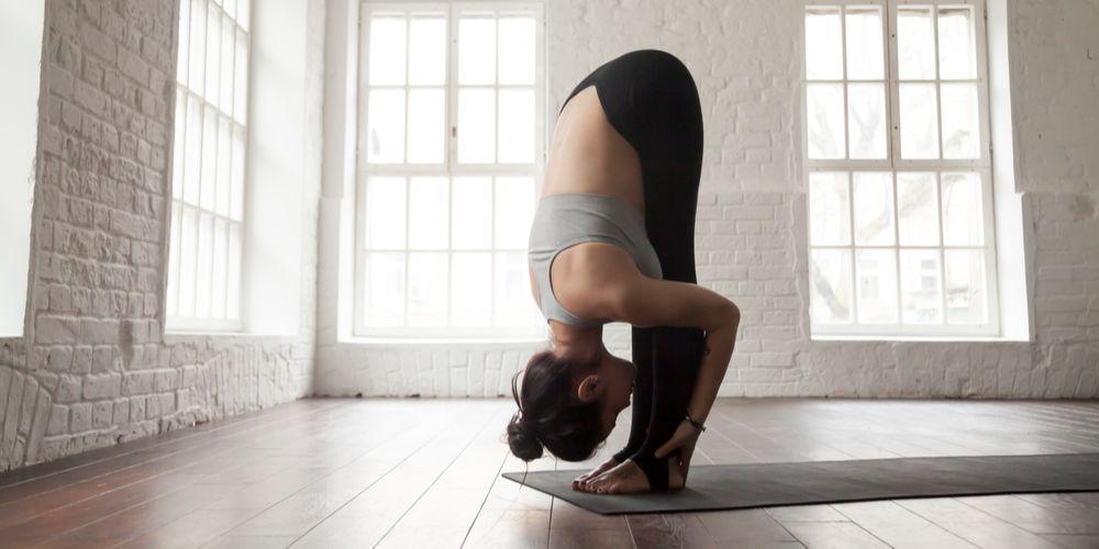 Standing forward bend yoga namaskar sun salutation